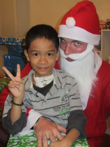 Huy Anh is till with us, so happy to receive this photo with him and Santa